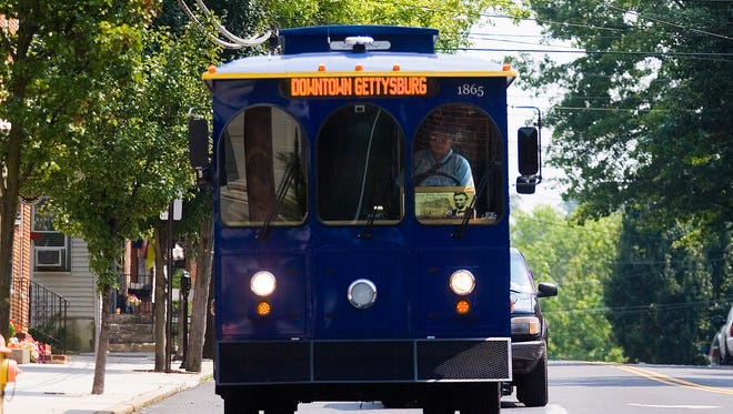 Freedom Transit driver Chris Walton navigates his trolley down Baltimore Street on Monday in Gettysburg.