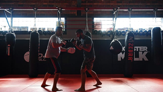 Devin Clark, a Sioux Falls mixed martial arts fighter, works with his striking coach Lucas Evjen Thursday, June 30, 2016, at Next Edge Academy in Sioux Falls.