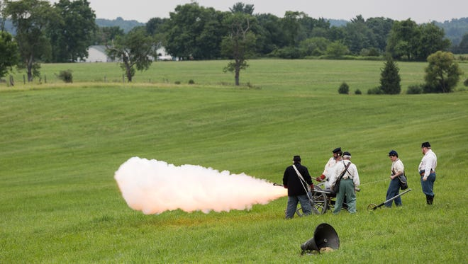 Cannon fire demonstrations take place during the 153rd Battle of Gettysburg re-enactment on June 1, 2016 in Gettysburg. - Harrison Jones for the Evening Sun