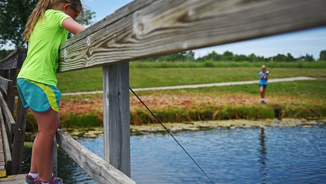 """Abby Roeder, 9, of Lennox, S.D., fishes in Discovery Pond during a """"Bait & Tackle"""" Junior Angler class Tuesday, July 5, 2016, at the Outdoor Campus in Sioux Falls. The goal of the Junior Angler program is to teach kids about the skills and ethics that go into fishing. In Tuesday's class kids learned about the different types of bait that can be used to catch fish, practiced their casting technique and then spent time fishing in Discovery Pond."""