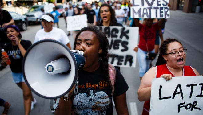 Rashida Anderson, 19 of West Des Moines, center, leads a march to the Des Moines Police Station during a Black Lives Matter solidarity rally on Friday, July 8, 2016 in Des Moines.