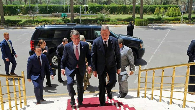 Visiting U.S. Defense Secretary Ash Carter, center left, accompanied by the Iraqi Defense Minister Khaled al-Obeidi, center right, arrives to the Ministry of Defense in Baghdad, Iraq, Monday, July 11, 2016.