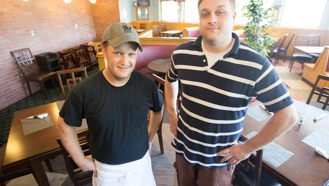 Owners Scott Kontney, left, and Tom Mandeville, right, at Tommy's American Grill located at 5110 Main Street in Stevens Point, Tuesday, July 12, 2016.