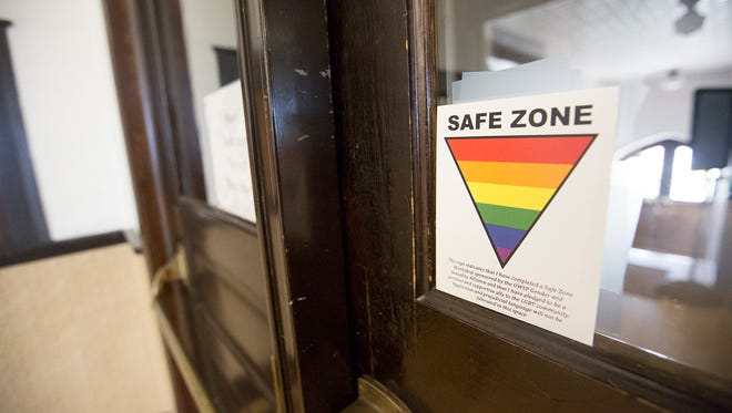 A sticker marks the church as a safe zone for the LGBTQ community at the Church of the Intercession located at 1417 Church Street in Stevens Point, Wednesday, July 13, 2016.