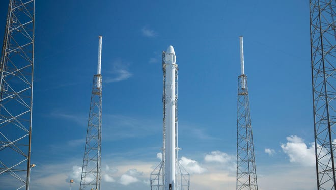 In this Saturday, July 16, 2016, photo provided by SpaceX, the SpaceX Falcon rocket stands at its launch pad at Cape Canaveral, Fla. The unmanned rocket is scheduled to blast off at 12:45 a.m. EDT Monday with 5,000 pounds of supplies for the International Space Station.