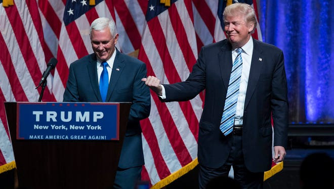 Republican presidential candidate Donald Trump, right, introduces Gov. Mike Pence, R-Ind., during a campaign event to announce Pence as the vice presidential running mate on, Saturday, July 16, 2016, in New York. (AP Photo/Evan Vucci)   ORG XMIT: OTKEV112