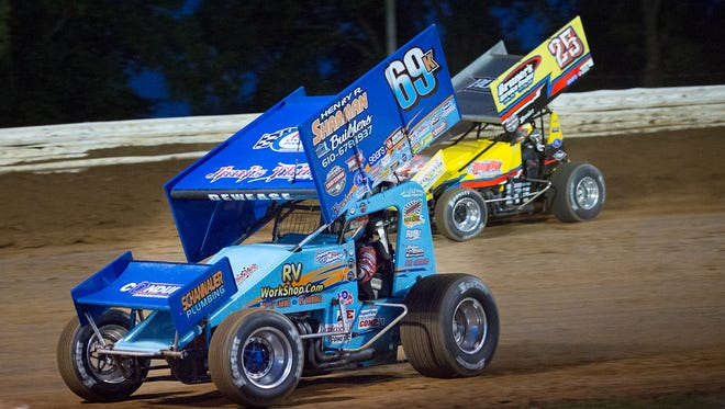 Lance Dewease takes the lead on Aaron Ott during their heat race.   Williams Grove Speedway host the Champion Racing Oil Summer Nationals Sanctioned by World of Outlaws Saturday, July 23, 2016.