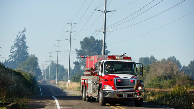 An engine from the Turner Fire Department responds to a five-alarm fire near the I-5 in Keizer on Thursday, July 28, 2016.