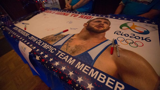 A banner with well-wishes from fans, friends, and family is on display during Ben Provisor's Olympic Send Off at Rookies Sports Pub in Stevens Point, Thursday, July 28, 2016.