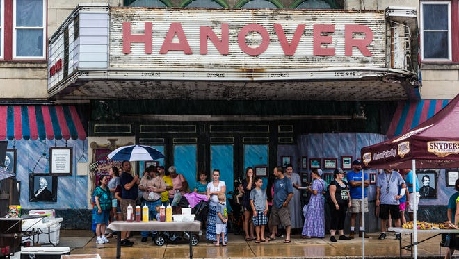 Festival attendees hide under the Hanover Theater marquee on Frederick Street as storms move in during the Hanover Dutch Festival in 2016. This year, Dutch Days returns with food, vendors and live music on Saturday, July 29.