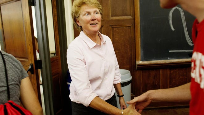 Lori Berquam, UW-Madison dean of students, shakes hands with incoming freshmen during an orientation program at Sterling Hall in July.