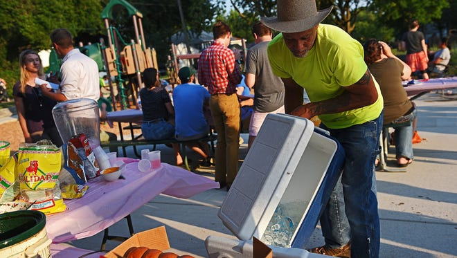 George Hamilton, of Sioux Falls, switches out a cooler during a National Night Out event Tuesday, Aug. 2, 2016, at Lyon Park in Sioux Falls.