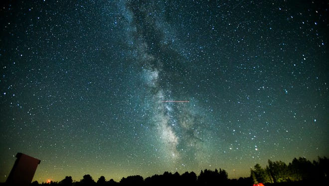 The public access area of Cherry Springs State Park in Coudersport, Potter County, Pennsylvania, offers a 360-degree view of the night sky. The Milky Way extends over the sitting area, complete with a screen) on Aug. 8.