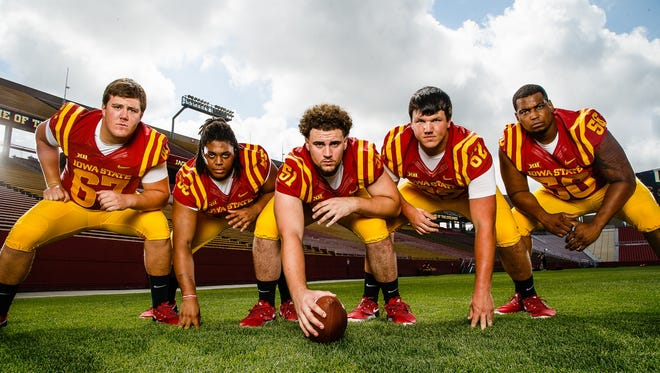 The Cyclones offensive line, from left, Jake Campos, Patrick Scoggins, Julian Good-Jones, Nick Fett, and Jaypee Philbert Jr., pose for a portrait during media day on Tuesday, August 9, 2016 in Ames.