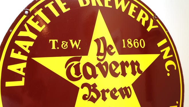 A Ye Tavern Brew sign that is part of Walter Griffin's collection.
