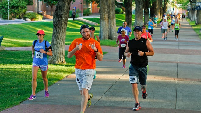 Runners travel through the Quad on the Nevada campus in the Reno 10 Miler & Relay.