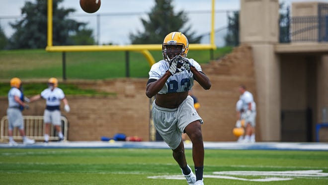 Augustana's Montrell Moore (83) catches a pass while taking part in a drill during a practice Friday, Aug. 12, 2016, at Kirkeby-Over Stadium on the Augustana University campus in Sioux Falls.