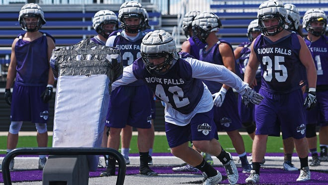 USF's Jess Williams takes part in a drill during a practice Friday, Aug. 12, 2016, at the University of Sioux Falls' Bob Young Field in Sioux Falls.