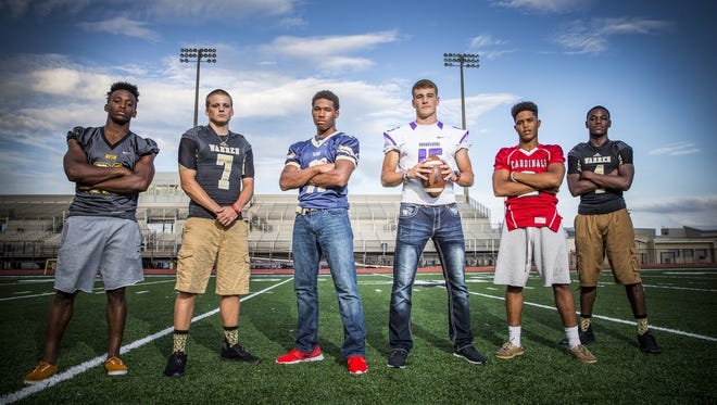 From left, Bryant Fitzgerald, running back for Avon, Zach Summeier, quarterback for Warren Central, Tyrone Tracy, running back for Decatur Central, Hunter Johnson, quarterback for Brownsburg, Blake Evans, wide receiver for Southport and David Bell, wide receiver for Warren Central.  Portrait taken at Ben Davis High School on Aug. 10, 2016.