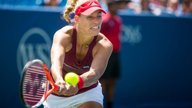 World No. 2 Angelique Kerber punched her ticket to the Western & Southern Open semifinals by defeating Carla Suarez Navarro 4-6, 6-4, 6-0 in a Friday quarterfinal in Mason.