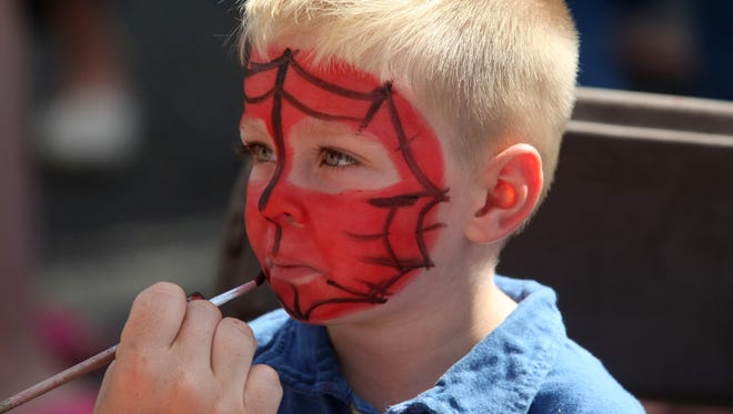 Face-painting is a favorite part of festival fun for many kids, including this little guy at the Red Bank  Guinness Oyster Festival in  2014.