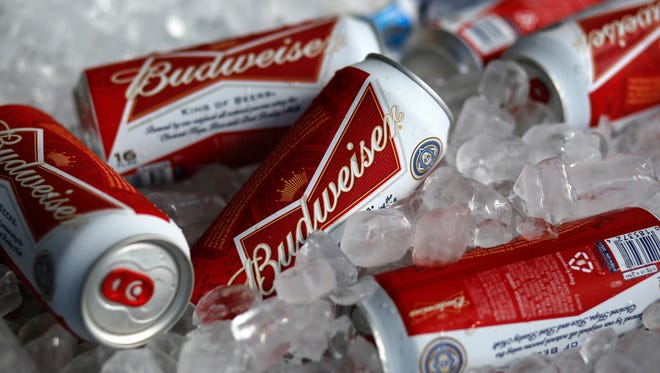 Budweiser beer cans are seen at a concession stand at McKechnie Field in Bradenton, Fla.