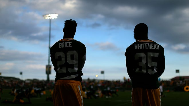 Green Bay Packers safeties Kentrell Brice (29) and Jermaine Whitehead (35) look on from the sidelines during training camp practice at Ray Nitschke Field on Monday, Aug. 1, 2016.