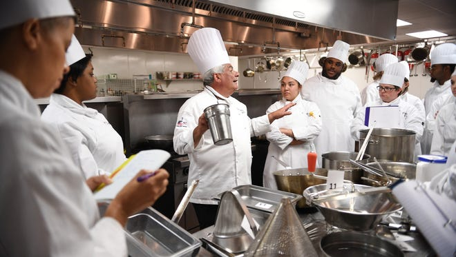 Chef Michael Granata teaches Principles of Food Production I to students of the Culinary Institute of the Carolinas at the Greenville Technical College Northwest campus on Wednesday.