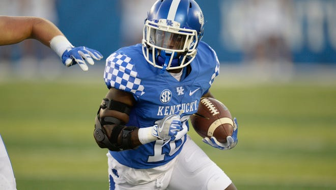RB Boom Williams runs the ball during the University of Kentucky football game against Southern Mississippi at Commonwealth Stadium in Lexington, KY on Saturday, September 3, 2016.