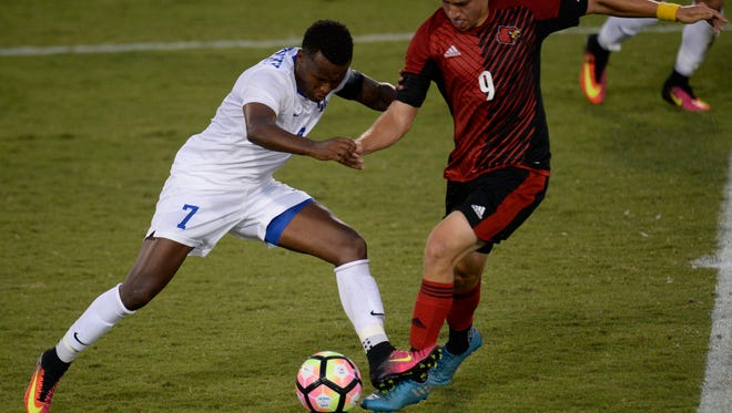 UK's Napo Matsoso is challenged by U of L's Tate Schmitt  during the University of Kentucky mens soccer match against University of Louisville at the Wendell & Vickie Bell Complex in Lexington, KY on Tuesday, September 6, 2016.