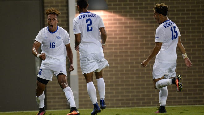 UK's Noah Hutchins celebrates his goal with teammates during the University of Kentucky mens soccer match against University of Louisville at the Wendell & Vickie Bell Complex in Lexington, KY on Tuesday, September 6, 2016.