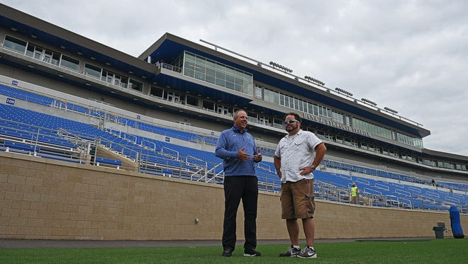 Justin Sell, director of athletics at South Dakota State University, does an on-camera interview with Argus Leader Media's Matt Zimmer during a tour of Dana J. Dykhouse Stadium Thursday, Sept. 1, 2016, on the South Dakota State University campus in Brookings, S.D.