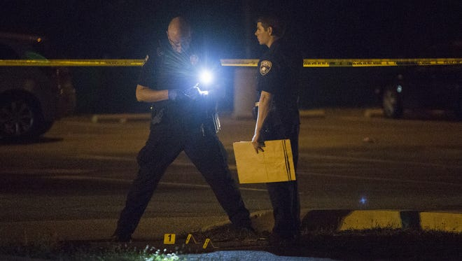 A York City police officers work the scene of a double shooting. Two people were shot near Small Athletic Field during a high school football game. The shooting took place during the William Penn home football game against J.P. McCaskey. The game was called, with the final score 26-6 McCaskey, Friday, September 9, 2016.