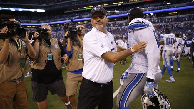Indianapolis Colts head coach Chuck Pagano makes his way to the 50 yard line to shake hands with Detroit Lions head coach Jim Caldwell at Lucas Oil Stadium on Sept. 11, 2016.