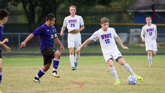 Former All-WNC striker Tyson Hichman (10) scored his 100th career goal Wednesday night for West Henderson.