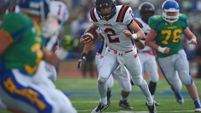 Washington's Jayden Johannsen (2) carries the ball during a game against O'Gorman Friday, Sept. 16, 2016, at McEneaney Field on the O'Gorman High School campus in Sioux Falls.