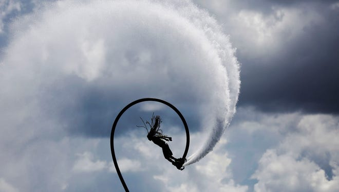 Hussein Ibrahim, of Maldives, competes in the Flyboard World Cup Championship at Sugden Regional Park in East Naples on Sunday, Sept. 18, 2016.