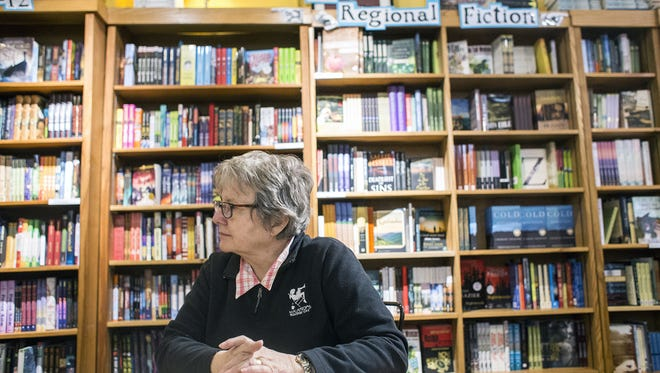 Malaprop's Bookstore Cafe owner Emoke B'Racz sits in her downtown shop.