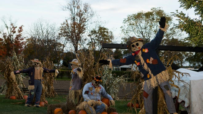 Greenfield Village lights up its streets and alleys with more than 1,000 jack-o'-lanterns around Halloween time.