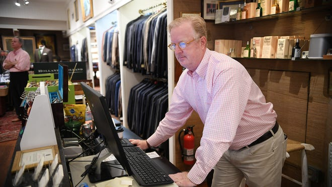 Chip Ervin keeps his King Street store in Charleston's historic district open Thursday. Many businesses are closed in Charleston's historic district as the city prepares for Hurricane Matthew.