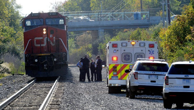 Emergency crews at the scene of a fatal train crash involving a 13-year-old boy Monday, Oct. 9, 2016, near the intersection of Haslett and Marsh roads in Haslett.