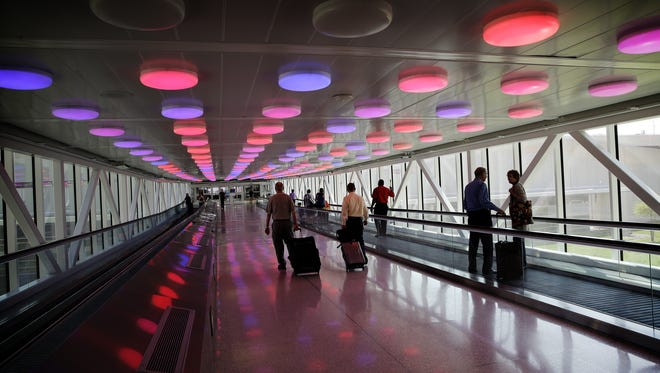 The walkway leads travelers to and from parking areas at Indianapolis International Airport.