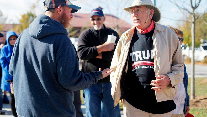George Gosnell talks to vendor Kevin Terry as he waits in line to see Donald Trump speak October 21, 2016.