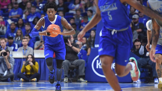 UK's De'Aaron Fox passes the ball up court during the University of Kentucky Blue-White basketball scrimmage at Rupp Arena in Lexington, KY on Friday, October 21, 2016.