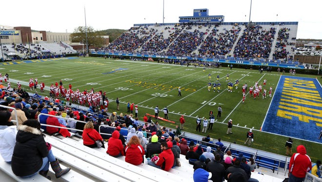 A crowd of 12,972 watches as the Hens try to score in the second quarter of Delaware's 28-3 loss at Delaware Stadium Saturday.