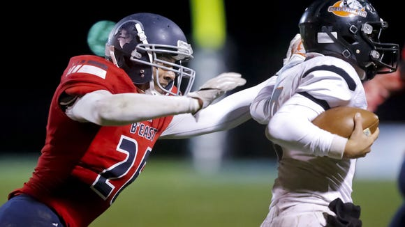 Brookfield East's Caleb Wright sacks Cedarburg quarterback Jack Meyer during the third quarter of the Spartans' 38-8 home victory in a WIAA Division 2 Level 1 playoff game Friday, October 21, 2016.
