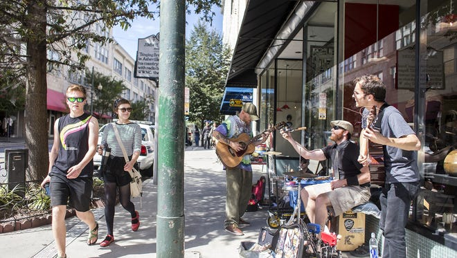 Buskers perform outside Woolworth Walk in this 2014 photo.