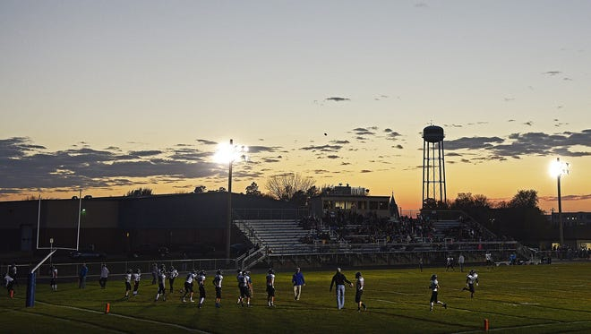 Players warm up before a 9AA quarterfinal game between Baltic and Mt. Vernon/Plankinton on Monday, Oct. 31, 2016, in Baltic, S.D.