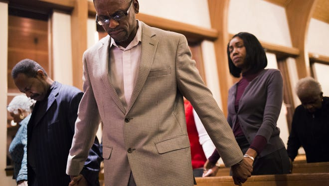 Pastor Larry Walthour II of Shiloh Baptist Church, center, prays. Shiloh Baptist Church in York held a prayer service on Monday, Election Day eve.