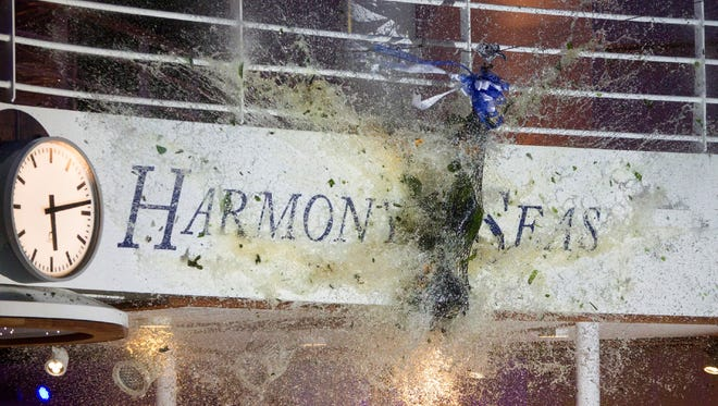 A bottle of champagne smashes during the Nov. 10, 2016 christening of Royal Caribbean's Harmony of the Seas, the world's largest cruise ship.